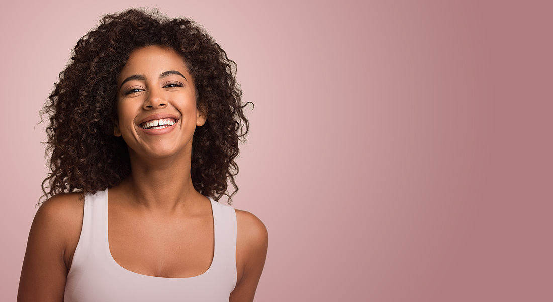 Happy woman on pink background